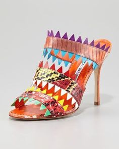 I love the 4 inch heel....I just cant wear them for over an hour if I have to stand....why, why, why do I have to stand? They are gorgeous. Arpegeny Snake-Band Slide Sandal by Manolo Blahnik at Neiman Marcus.