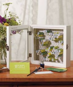 Wishes rolled up in shadow box w chicken wire to hold in place