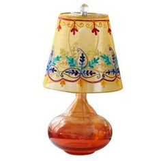 "Orange glass table lamp with an embroidered floral shade.   Product: Table lampConstruction Material: Glass and cottonColor: OrangeDimensions: 18"" H x 9"" DiameterCleaning and Care: Spot clean"