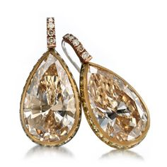 A PAIR OF COLORED DIAMOND EAR PENDANTS, BY HEMMERLE Pear shaped diamonds weighing 7.67 and 7.77 carats