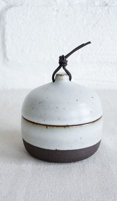 Len Carella Rounded Cannister with Leather Tie