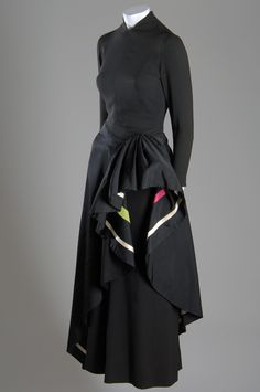 Irene Castle Dress Black silk crepe, ecru lace, embroidery Circa 1923, USA The dancer Irene Castle was known for her romantic and modern style. She parlayed her status as a fashion icon into a successful collaboration with Corticelli Silks, designing and promoting clothes based on her personal taste.