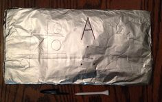 """Fine motor-sensory strategy for decreasing pencil/crayon pressure and promoting correct grasp pattern--- Wrap a piece of aluminum foil around cardboard and use a golf tee (or even pen cap). Try games (ex. Tic-tac-toe), practicing the alphabet, or free drawing. If the child uses too much pressure the foil will tear. They will need to """"retrain"""" their hands to use less pressure."""