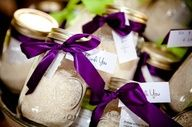 Mason jar wedding favors with some sort of a dried recipe in them.