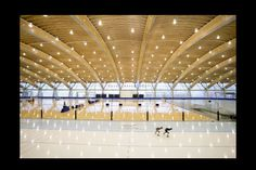 The interior shot shows the Richmond Olympic Oval configured as one skating track, with the huge composite beams spanning the space.