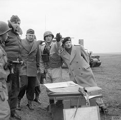 26 February 1944. Left to right: Air Chief Marshal Sir Arthur Tedder, General Dwight D Eisenhower and General Sir Bernard Montgomery.