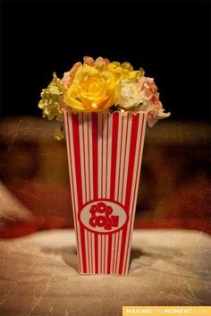 MakingTheMoment_DG_163 by Hair Architect, via Flickr. Popcorn centerpiece for carnival wedding.