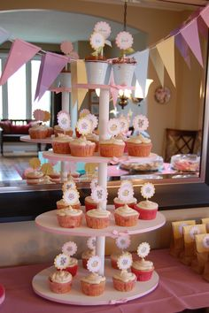 Cupcake tower for baby shower. Made the stand myself with dowels, screws and epic amount of hot glue. Cupcake toppers are with Stampin' Up! product.