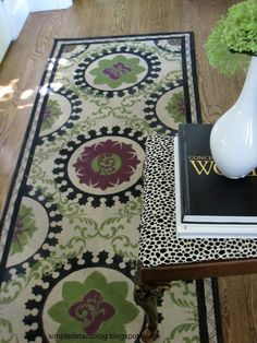 Not sure I want to do THIS much work, but...DIY Painted Stenciled Suzani Style Rug at Simple Details. Fabulous!
