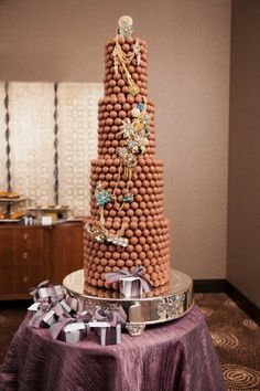 TRUFFLE TOWER CAKE-    This could be made of white truffles, for a beautiful wedding cake.