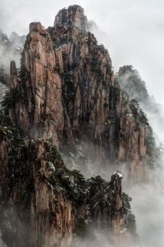 Huangshan Mountain, Anhui, China. Taken from the Beginning-to-Believe Peak after morning snowfall. The lingering fog made the scene look like Chinese painting.