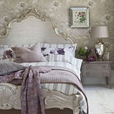 Bed. Headboard, Footboard painted Silver: Glamorous silver bedroom:: This stylish bedroom combines silver gilding, glamorous furniture and large-scale prints for a modern twist on a classic look. House to Home UK