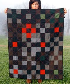 gorgeous hand-stitched quilt by folk fibers
