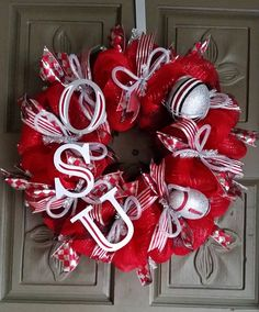 This is a gorgeous Ohio State Buckeyes deco mesh wreath. It is made of red and silver deco mesh, and red, silver and black ribbon. Ohio State Wreath, Ohio State Crafts, Christmas Projects, Christmas Wreaths, Fun Projects, Xmas, Football Wreath, Football Crafts, Deco Mesh Wreaths