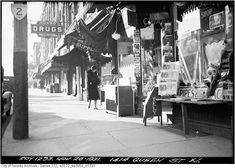 1414 Queen West in Parkdale, 1931, looking west along the sidewalk towards O'Hara Avenue.