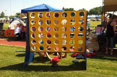 Fundraising Game - Giant connect four game at a Relay For Life team campsite. Fun and Creative Fundraising Ideas, http://hative.com/fun-creative-fundraising-ideas/,