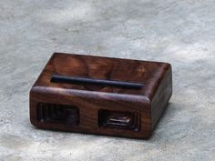 """Acoustic iPhone 5 dock in Black Walnut - Amplifies sound through unique acoustical pockets . Made me think of Daniel but I don't have an """"Ohhhh for Daniel"""" page. ;-)"""
