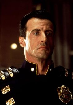 Sylvester Stallone returns as Barney Ross. Sylvester Stallone, Judge Dredd Movie, Videogames, Demolition Man, Punisher Marvel, 90s Movies, Rocky Balboa, The Expendables, Tough Guy