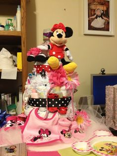 My mother actually made this one! What an adorable Disney's Minnie Mouse diaper cake for a baby girl! Such a wonderful baby shower gift and fun to make! ★ ★ ★ ★ ★