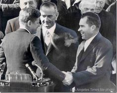 The new President shakes hands with his opponent from the 1960 Presidential election, the defeated Richard Nixon.