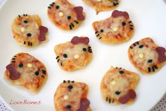 """I baked if first with cheese only and half way through I took it out and put the olive eyes and whiskers and pepperoni hair bow then put it back in the oven and just before it cooled I put the slice cheese noses!"""
