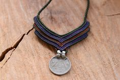 handmade macrame necklace with old Indian vintage coin the waxed threads are high quality and are in green kaki,purple and caffe taba color the pendant has adjustable length with sliding clasps with maximum length at 70 cm (27,5 inches)