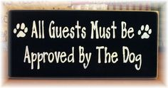 All guests must be approved by the dog primitive wood sign. $12.00, via Etsy.