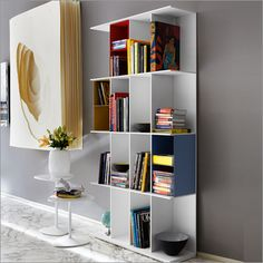 """Calligaris """"Division"""" bookcase by design lab.  Aluminum containers in sky blue, mustard yellow, red, or taupe slide in for portable partitions."""