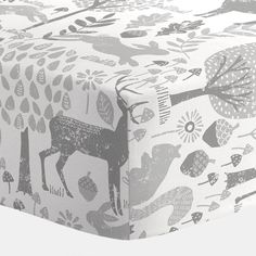 Crib Fitted Sheet in and Gray Woodland Animals by Carousel Designs.