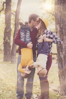 Fun family pose and fall outfits.
