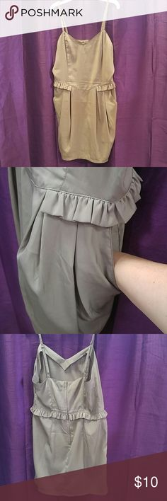 Divided H&M size 10 taupe dress with pockets Adjustable spaghetti straps. Ruffle trim at waist. Deep pockets! Neutral color gives you endless options to accessorize! Divided Dresses Mini