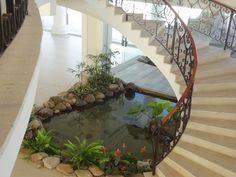 26 Best Home Stairs Design Ideas With Aquarium - Aquarium decorations have the tendency to look rigid and lifeless. If you look at the various types of fish tank decorations sold, they mainly depict . Home Stairs Design, Home Room Design, Dream Home Design, Modern House Design, My Dream Home, Small Garden Under Stairs, Small City Garden, Garden Kids, Fish Pond Gardens
