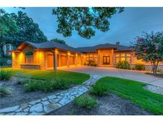 Lush landscape, three car garage and well lit front porch that gives this house a curbside appeal 9538 Westminster Glen Ave, Austin TX 78730