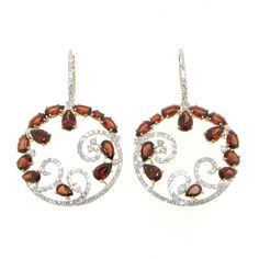 Casato Roma Gioielli: 18 Kt Rose Gold earrings with Garnet and White Diamonds.