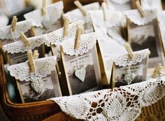 Style Me Pretty | Gallery | cute little brown paper bags trimmed with a doily and topped with a tiny clothes pin. Good for small gifts or maybe party favors.