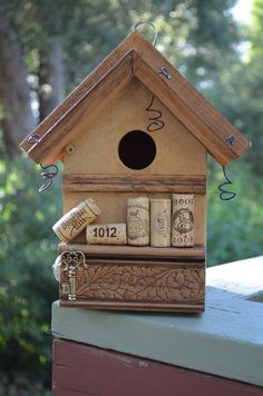 Find other creations like this one at www.naturaluniquebirdhouses.com like this Rustic Birdhouses Wine Corks Recycled Wren by BirdhousesByMichele, $60.00  Save corks? Why not store them in your favorite decorative birdhouse.
