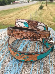 Hand tooled and painted leather dog collars. Made by Collier's Tack & Supply.