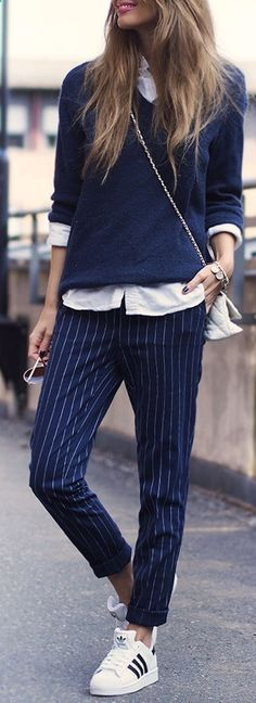 Women Clothing Annette Haga is wearing a sweater and pinstriped trousers  from Bik Bok fa36b94abd5