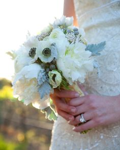 At this Wine Country wedding, anemones, peonies, ranunculus, rice flowers, and dusty miller felt fresh yet timeless.