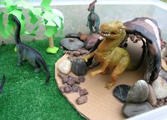 Creating a dinosaur small world play scene together provides a fun space for kids who love to play with dinosaurs Dinosaur Small World, Dinosaur Play, Dinosaur Crafts, Small World Play, Kid Crafts, Dinosaur Garden, Sensory Bins, Sensory Activities, Sensory Play