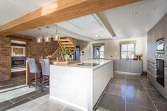 The Oak Frame Of This Countryside Home Brings Texture And Natural Warmth To  The Clean Surfaces Of The Bulthaup B3 Kitchen.