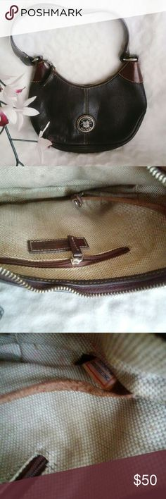 "Dooney & Bourke All Leather Small Hobo Handbag Pre-Loved Condition This Dooney & Bourke hobo has a classic shape with gorgeous hand-stitched leather, quality hardware and rich brown leather accents. Width 12.0"" Height 7.0"" Depth 2.5"" Handle Drop 12.0"" Material: Leather Dooney & Bourke Bags Hobos"