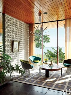 Custom-made ceramic tiles distinguish a corner of the space; the light fixture is by Rewire Gallery, the Warren Platner lounge chairs by Knoll are vintage, and the low table and rug are by Adler | archdigest.com