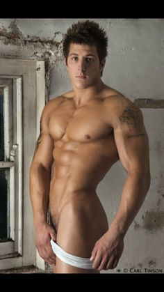 Handsome jock from college rubs his ripped torso