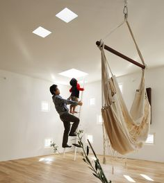 Almost a hundred small square windowsscattered across the walls, ceilings and roof of a house in Tokyo allow its occupants, a deaf couple and their children, to sign to each other through the walls evenwhen the children are playing outdoors.