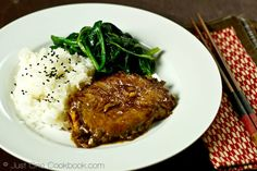 Simple pan fried tender Asian pork chop marinated in a ginger soy glaze, goes great with white rice.