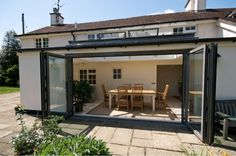Bi folding doors from apropos conservatories Glass Extension, Extension Ideas, Conservatory Garden, House Extensions, Kitchen Extensions, Folding Doors, Skylight, Architecture Details, My Dream Home