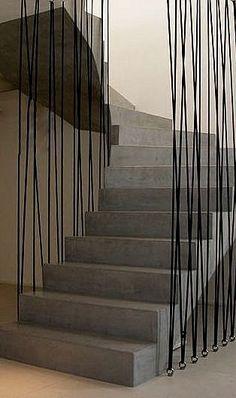 Striking architectural concrete staircase design. …