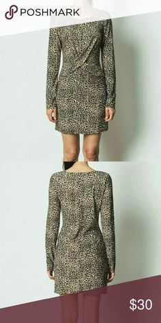 Cheetah bodycon dress Knit dress with long sleeves. 94% polyester, 6% spandex Small - 2/4 Medium  - 6/8 Large - 10/12 Dresses