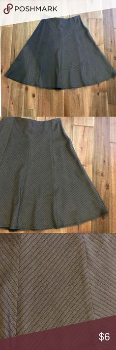 A line skirt size S in brown w/ maroon stripes EUC This deep brown A line skirt with thin maroon stripes is the perfect addition to any working woman's closet. It is in EUC with no stains, rips, or holes. Bundle with other items from my closet for the best deal! Luly K New York City Skirts A-Line or Full